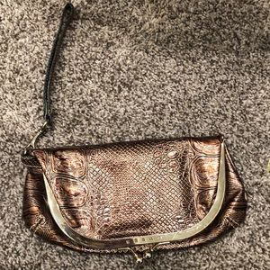 Guess clutch snakeskin dark purpleish color.